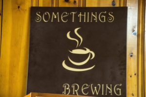 something's brewing sign